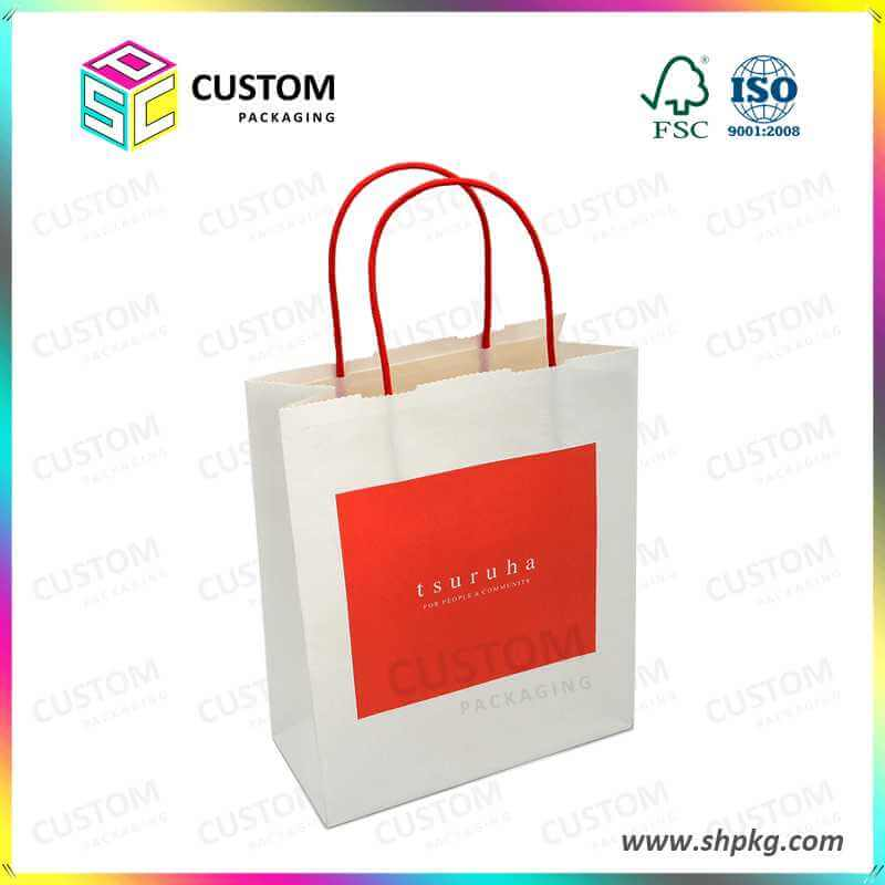 paper bag with red handle