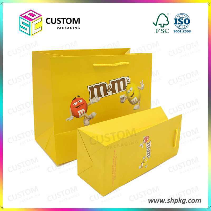 the yellow branded paper bag