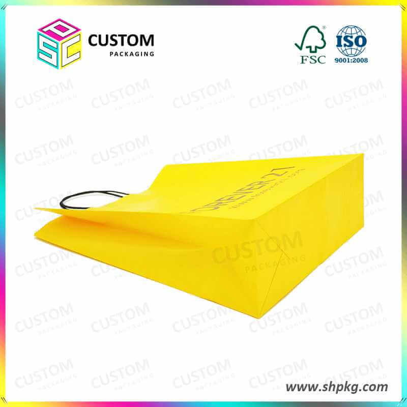 yellow shopping paper bag for apparel